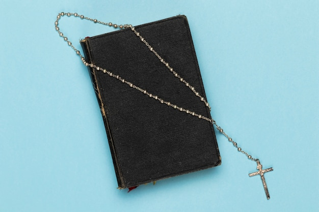 Top view holy book and necklace