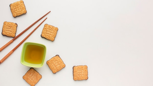 Top view homemade biscuits and chopsticks with copy space