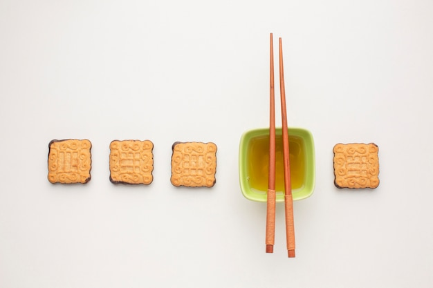 Top view homemade biscuits with chopsticks
