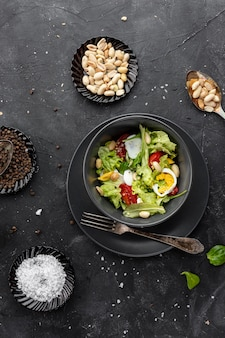 Top view homemade salad on dark background