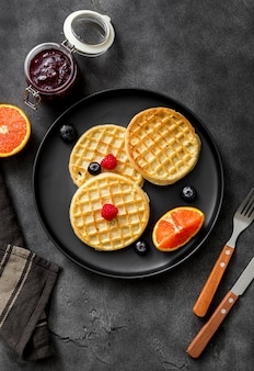 Top view homemade waffles on a plate