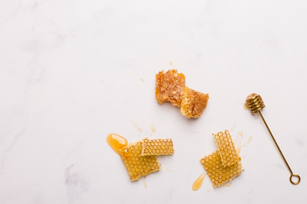 Top view honey spoon with honeycomb pieces