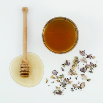 Top view honey with dried flowers