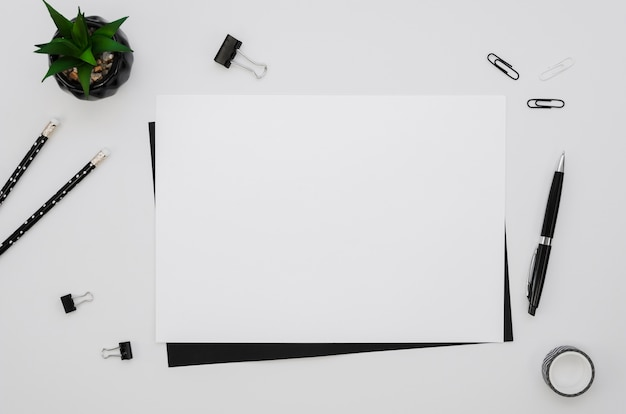 Top view of horizontal paper with office supplies