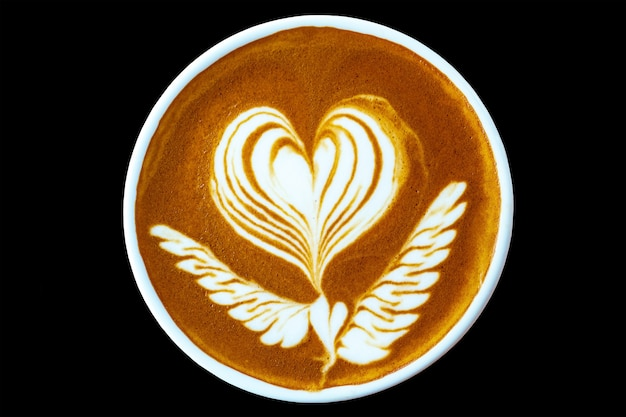 Top view of hot coffee latte art in a cup isolated on black background - beautiful latte art heart pattern