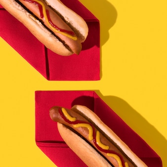 Top view hot dogs on red napkins