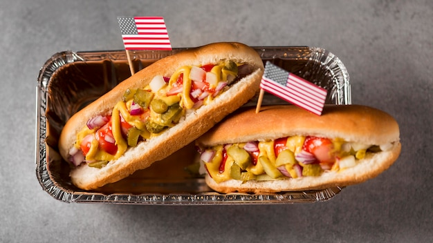 Top view hot-dogs with american flag in tray