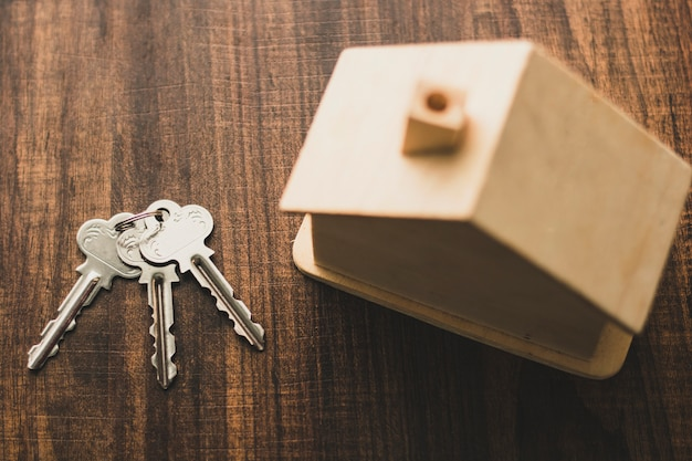 Top view of  house key and home model on table