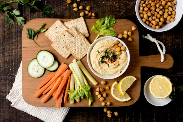 Top view of hummus with assortment of vegetables