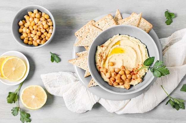 Top view of hummus with chickpeas and lemon