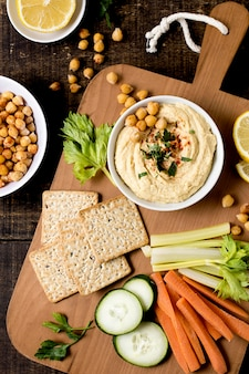 Top view of hummus with different vegetables