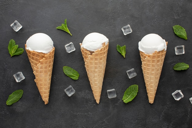 Top view ice cream on cones with ice cubes