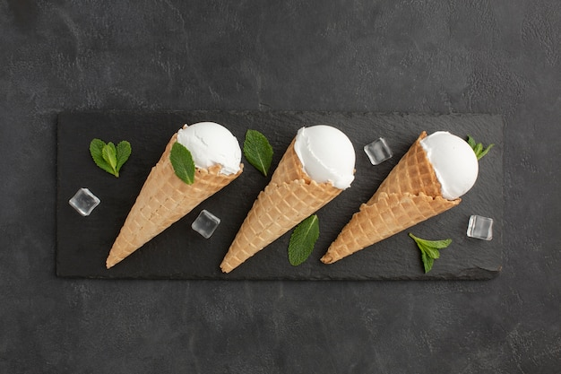 Top viewice cream on cones with ice cubes