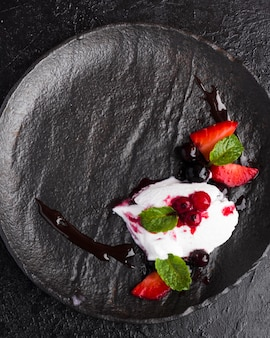 Top view ice cream on slate with fruits