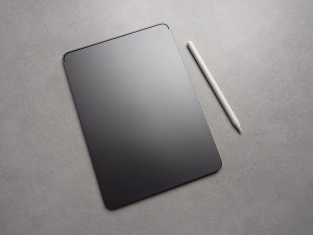Top view image of black blank new luxurious tablet with stylus pen