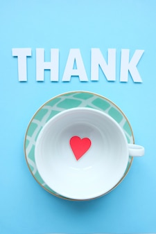 Top view image cup with phrase: thank, next and little red heart.
