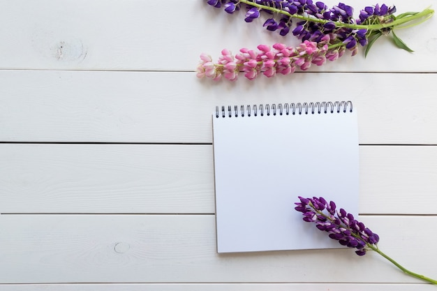 Top view image of open notebook with blank pages  on wooden background