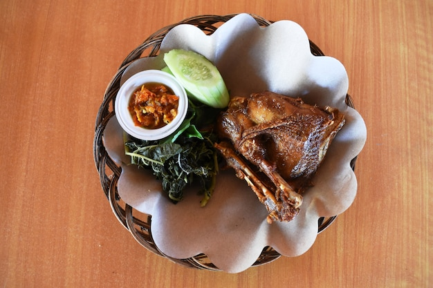 Top view of indonesian fried chicken is traditional indonesian culinary food