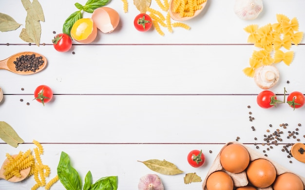 Top view of ingredients for making pasta with free space for text