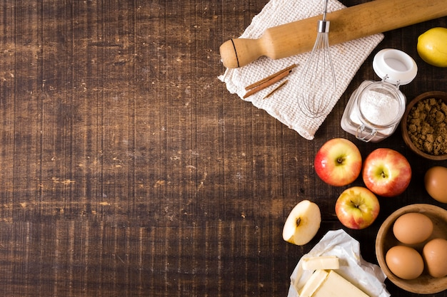 Top view of ingredients for thanksgiving pie with apples and eggs