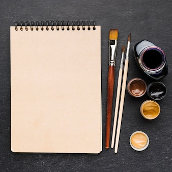 Top view ink pot and copy space notepad