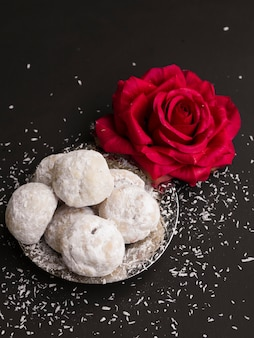 Top view islamic pastries with a red rose
