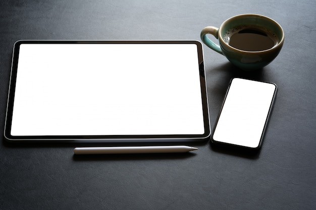 Top view of isolate tablet blank black screen on leather desk