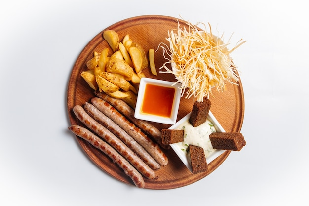 Top view on isolated beer appetizer snack platter on the white background