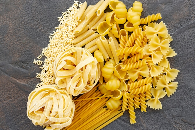 Top view of italian pasta on plain background
