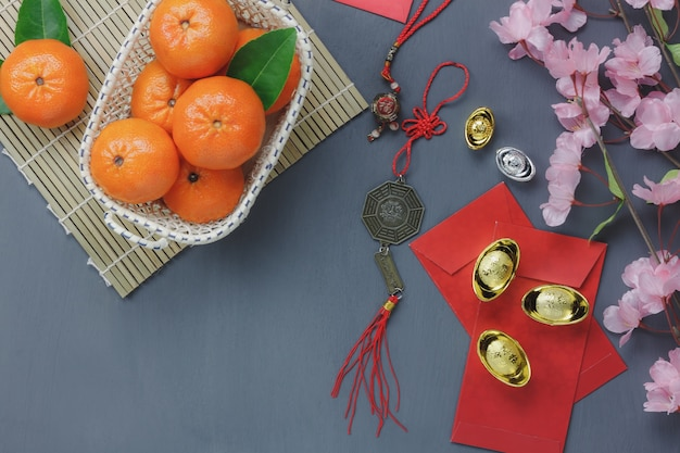 Top view of items for chinese happy new year concept background.different essential accessory on modern rustic table home decoration.mix objects for the festival season.free space for creative design.