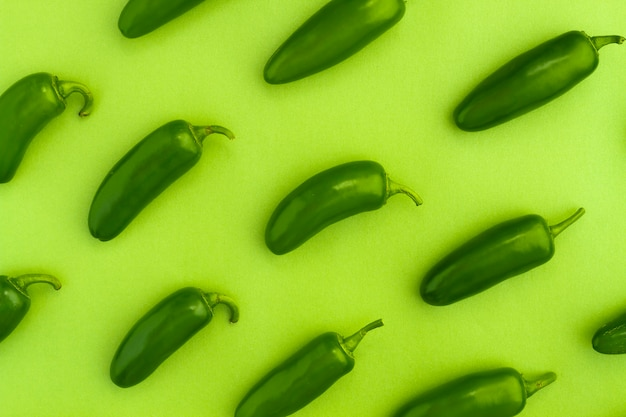 Top view jalapenos with green background