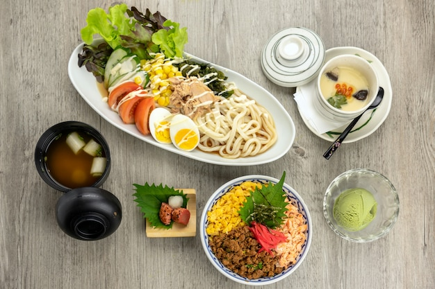 Top view of japanese foods set, fried rice with udon ramen with egg and tuna salad
