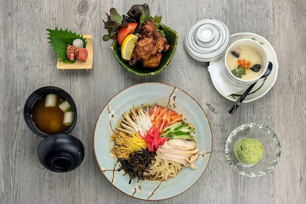 Top view of japanese foods set, ramen with fried chicken karaage rice serve with egg strea