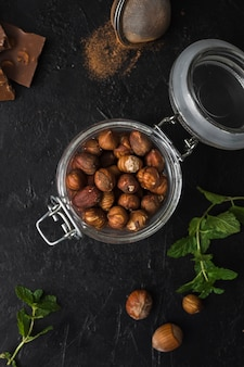 Top view jar filled with hazelnuts