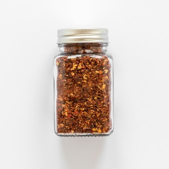 Top view jar with spices on white background