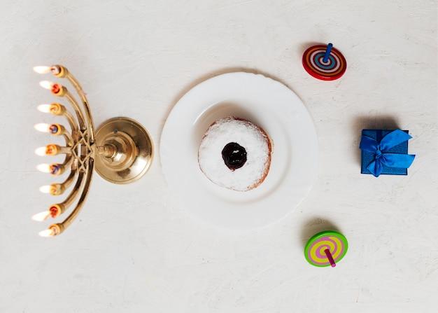 Top view jewish menorah and sweets
