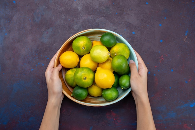 Top view juicy fresh citruses lemons and tangerines on dark desk citrus tropical exotic orange fruit