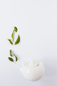 Top view of kettle with tea leaves