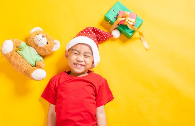 Top view of a kid dressed in red santa claus hat the concept of holiday christmas xmas day