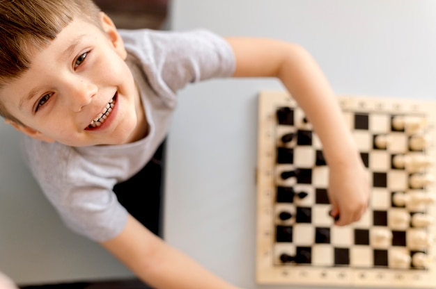 Top view kid with chess game