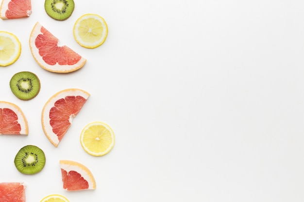 Top view of kiwi and citrus fruits  with copy space