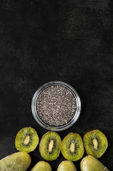 Top view of kiwi popsicles with poppy seeds