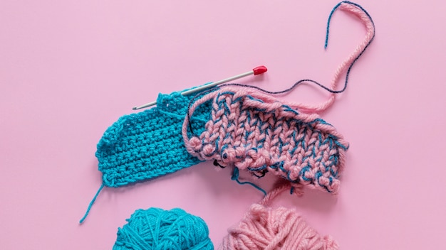 Top view knitting needles and wool