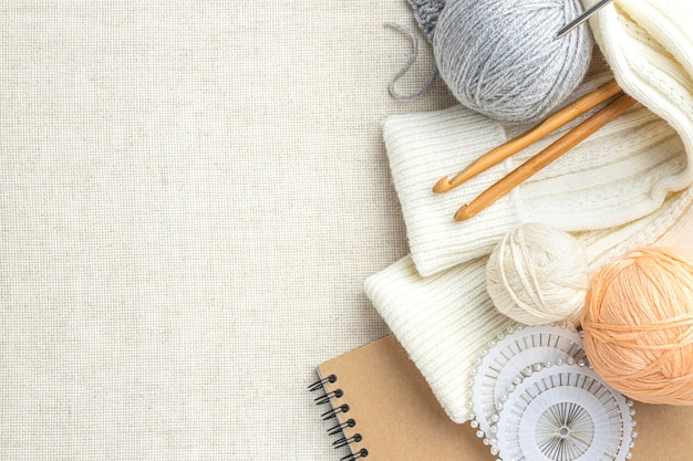 Top view of knitting set with yarn and copy space