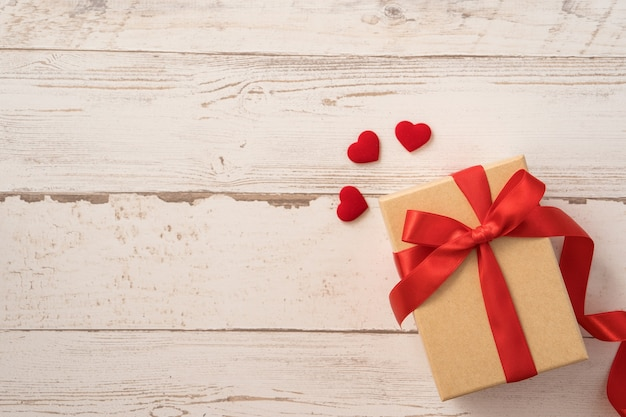 Top view of kraft gift box with red ribbon bow for valentine day.