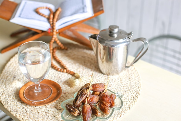 Top view of kurma or dates fruit with glass of water