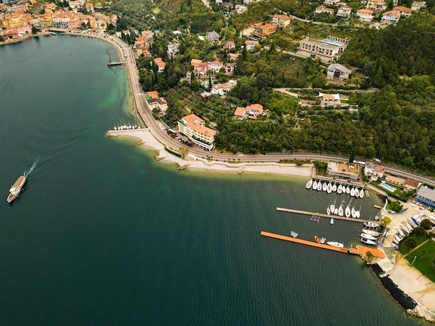 Top view of lake lago di garda and the village of torbole, alpine scenery. italy.
