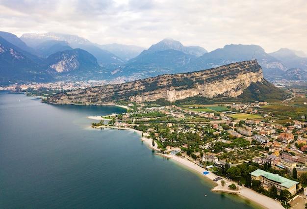 Top view of lake lago di garda and the village of torbole, alpine scenery