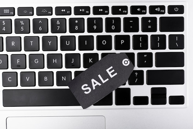 Top view laptop keyboard with sale tag