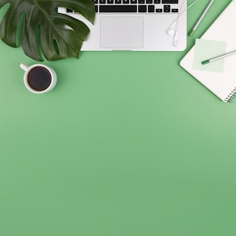 Top view of laptop with coffee and plant